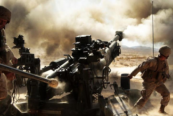 Guns and Military Pull the Cord  Marines with Battery N, 5th Battalion, 14th Marine Regiment, fire an M777 A2 howitzer during a series of integrated firing exercises at the Marine Corps Air Ground Combat Centter Twentynine Palms' Quakenbush Training Area April 26, 2013.  (