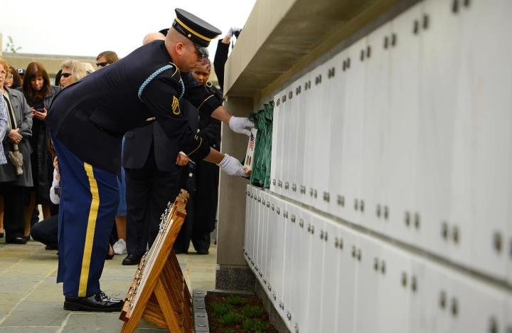 Guns and Military Staff Sgt. Michael Drake, infantryman, Delta Company, 3d U.S. Infantry Regiment (The Old Guard), places the remains of Civil War veteran, Pvt. Lycurgus McCormack, inside of the new Columbarium Court No. 9 in Arlington National Cemetery, Va., May 9, 2013 A