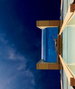 Wake World's Coolest Pools - Dive into swimming pools that provide unbeatable views and an instant sense of escape.  Article by Jimmy Im, Marguerite A. Suozzi