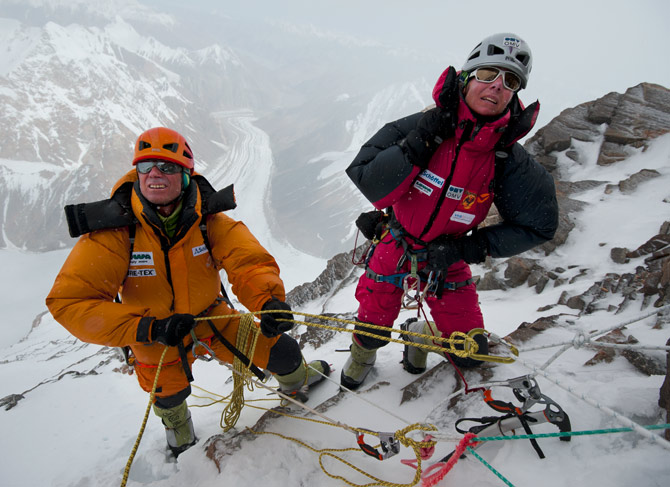 "Climbing Bundled in their down suits, Ralf Dujmovits and Kaltenbrunner study the route up toward Camp IV and the beginning of the ""death zone."""
