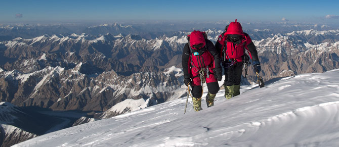 Climbing After Kaltenbrunner reached the summit of K2 first, Zhumayev and Pivtsov, bent with exhaustion, trudge the final steps shoulder to shoulder.