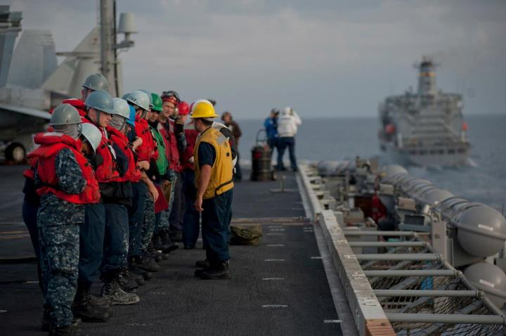 Guns and Military PACIFIC OCEAN (May 8, 2013) Sailors wait on the flight deck of the aircraft carrier USS Carl Vinson (CVN 70) as it pulls alongside the Military Sealift Command fleet replenishment oiler USNS Henry J. Kaiser (T-AO 187) to conduct a replenishment-at-sea. Ca