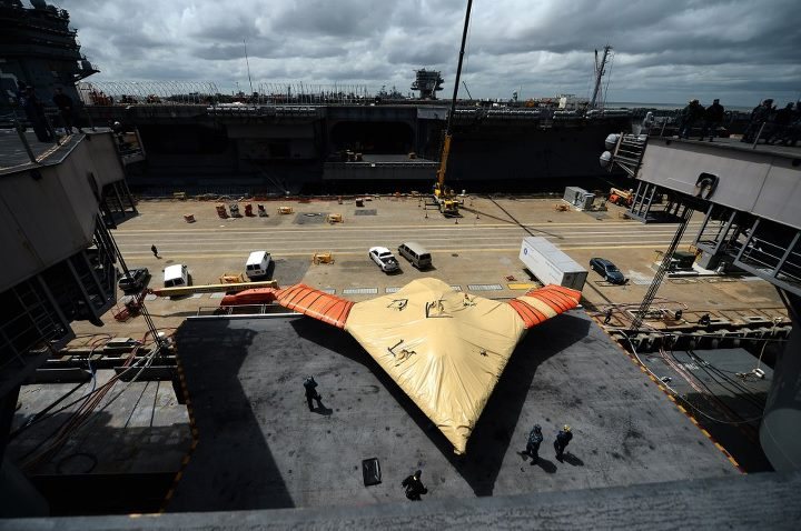 Guns and Military NORFOLK (May 6, 2013) An X-47B Unmanned Combat Air System (UCAS) demonstrator is lowered on an aircraft elevator on the aircraft carrier USS George H.W. Bush (CVN 77). George H.W. Bush is scheduled to be the first aircraft carrier to catapult-launch an un