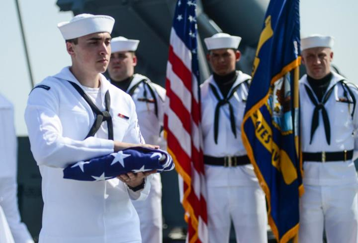 Guns and Military RED SEA (May 6, 2013) Religious Programs Specialist Seaman Daniel Tomaso carries a national ensign during a burial at sea on the fantail aboard the guided-missile cruiser USS Monterey (CG 61). Monterey is deployed supporting maritime security operations a