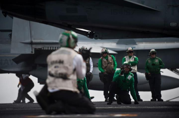 Guns and Military PACIFIC OCEAN (May 4, 2013) Final checkers from the Mighty Shrikes of Strike Fighter Squadron (VFA) 94 look over an F/A-18C Hornet before it launches off the flight deck aboard the aircraft carrier USS Carl Vinson (CVN 70). Carl Vinson and Carrier Air Win