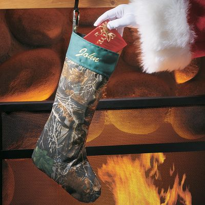 Hunting Santa will have no doubt who the outdoorsman is on his list when he spots this stocking hanging over the hearth especially since its personalized with the name of your choice. Made of 100% cotton denim. Hanging loop. Embroidery color as shown. Made in USA. Length: 16. Camo patterns: Cabelas Seclusion 3D Thread color: Light Yellow.. Realtree APC (Pink) Thread color: Pink. Mossy Oak Break-Up Thread color: Brown. Realtree MAX-4 Thread color: Brown. Cabelas Zonz Woodlands Thread color: Light Yellow. Mossy Oak (Pink) Thread color: Pink. Personalization is available for an additional $5. Color: Camo. - $12.99