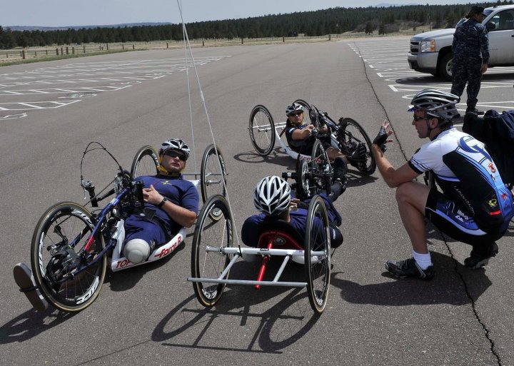Guns and Military COLORADO SPRINGS, Colo. (May 6, 2013) Team Navy cyclists listen as their coach provides them with suggestions to make the ride easier in preparation for the 2013 Wounded Warrior Games. The Warrior Games includes competitions in archery, cycling, seated vo