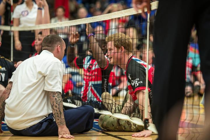 Guns and Military COLORADO SPRINGS, Colo. (May 11, 2013) Prince Harry and retired Navy Aviation Electrician's Mate Steven Davis chatting it up at the Warrior Games seated volleyball exhibition game. More than 200 seriously wounded, ill, and injured service members from the