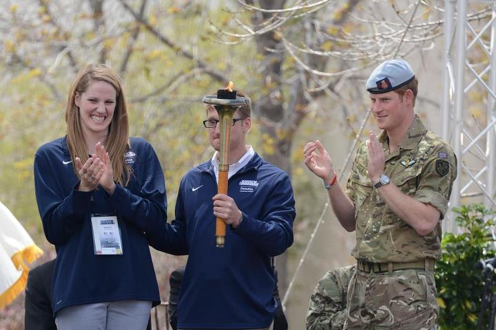 Guns and Military Olympian Missy Franklin, paralympian gold medal winner Navy Lt. Bradley Snyder and Prince Harry prepare to light the official torch to begin the 2013 Warrior Games at the U.S. Olympic Training Center in Colorado Springs, Colo., May 11. From May 11-16, mor