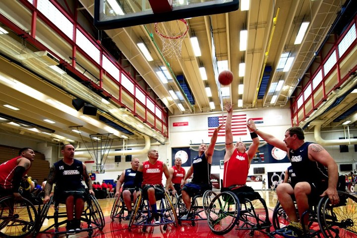 Guns and Military COLORADO SPRINGS, Colo. — Marine and Navy wheelchair basketball players fight for a rebound during the first round of the wheelchair basketball tournament at the 2013 Warrior Games here May 12. From May 11-16, more than 200 wounded, ill and injured servic