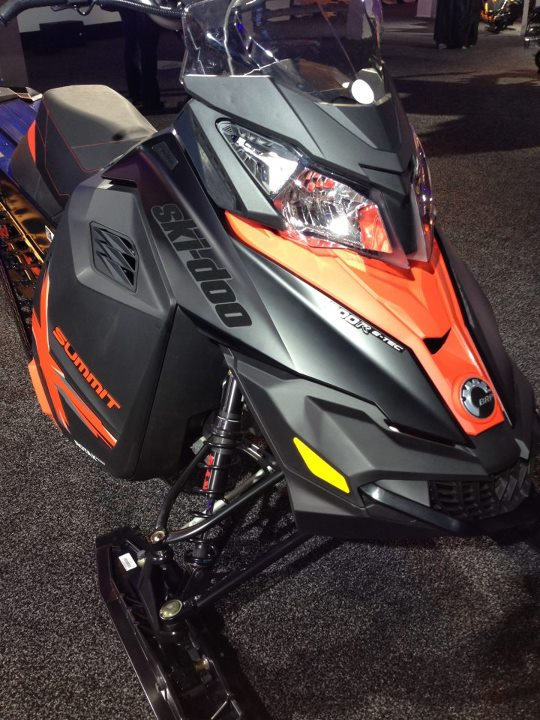 Snowmobile 2014 Summit X black-red. New Matte black hood; black logo decal has metallic flake. Super stealth, super premium look.