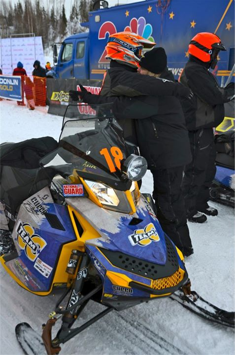 Snowmobile A good luck hug at the start