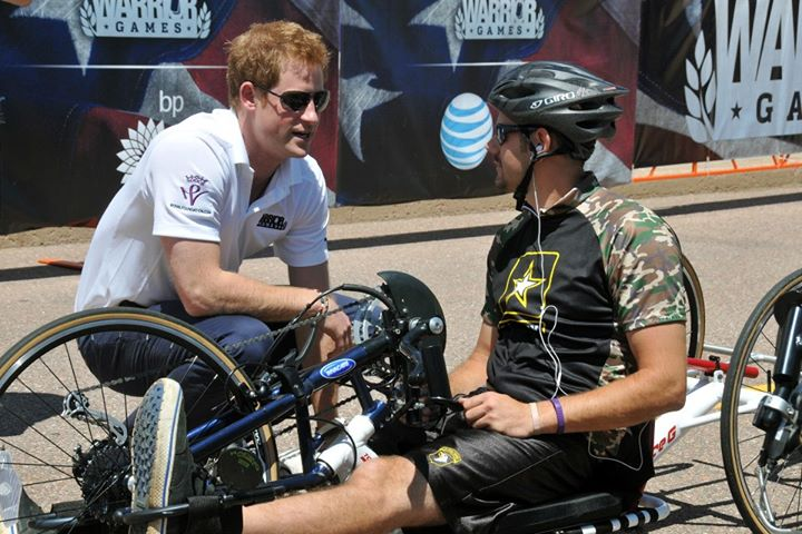 Guns and Military Prince Harry offers words of encouragement to Army veteran Blake McInn before the start of the 2013 Warrior Games recumbent bike cycling competition near the US Air Force Academy (Official) in Colorado Springs, Colo., May 11. From May 11-16, more than 200