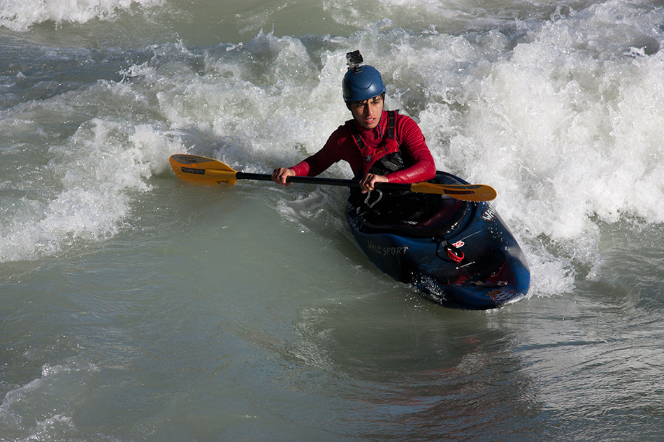 "Kayak and Canoe Yonathan Vargas, one of the ""river sharks"" of the Club Naútico Escualo, surfs in Rapido Borgies"