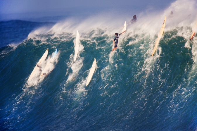 Surf Wow Wednesday!  Today an image of a huge wave breaking in Waimea....the surfers barely scrape over the wave!  Photo by awesome surf photographer Lucia Griggi.