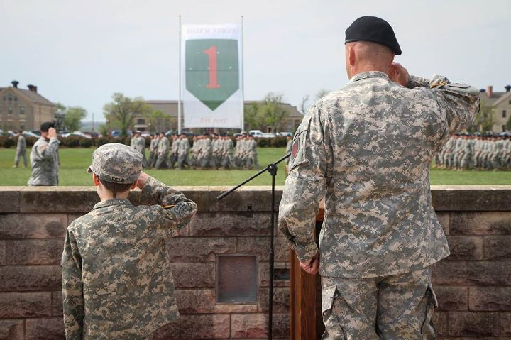 "Guns and Military Command Sgt. Maj. Ian Field (left) and Lt. Col. James Lander (right), the incoming commander of the 1st Battalion 28th Infantry Regiment ""Black Lions"", 1st Infantry Division, salute during a pass in review at the battalion's change of command ceremony May"