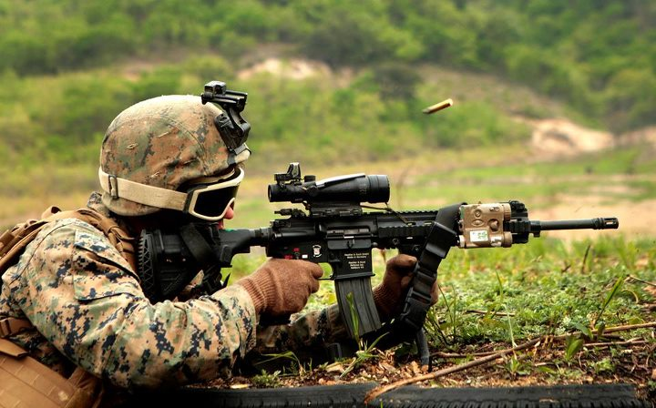 Guns and Military Twin Dragons  A Marine with 1st Battalion, 3rd Marine Regiment, currently assigned to 4th Marine Regiment, 3rd Marine Division, III Marine Expeditionary Force as part of the Unit Deployment Program, provides suppressive fire with an Infantry Automatic Rif