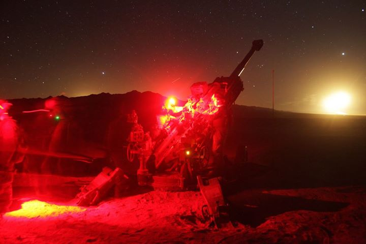 Guns and Military In the Heat of the Night  Marines with Battery M, 3rd Battalion, 11th Marine Regiment, 1st Marine Division load an M777 lightweight 155mm Howitzer for firing during Exercise DESERT SCIMITAR aboard Marine Corps Air-Ground Combat Center Twentynine Palms, Ca