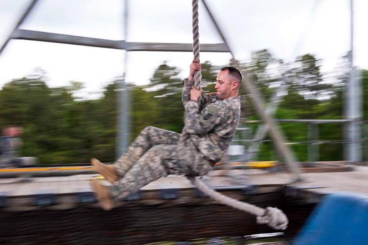 Guns and Military Army Staff Sgt. Jesse Mullinax, South Carolina National Guard, swings across a pit during the Region 3 Best Warrior Competition at McCrady Training Center on Fort Jackson, S.C., May 1. Soldiers from 10 states and territories competed for four days for a p