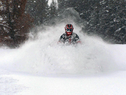 Snowmobile Get Chest Deep in Wyoming's Backcountry - reserve your backcountry tour @ togwoteelodge.com