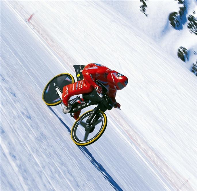 MTB Mountain biker rockets down ski slope at 135 mph - Eric Barone from France sets world record for speed on a serial production mountain bike.  Article by David Strege