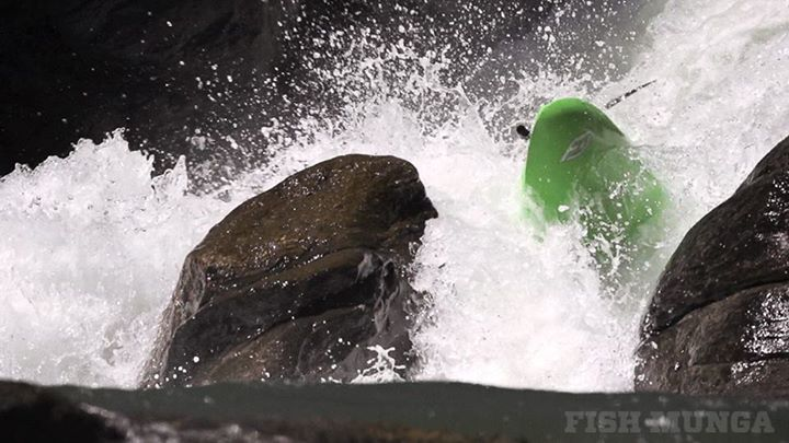 Kayak and Canoe Steve Fisher chest slams a massive rock while running two ContourROAM2 cams, one on his boat and the other on his helmet. 