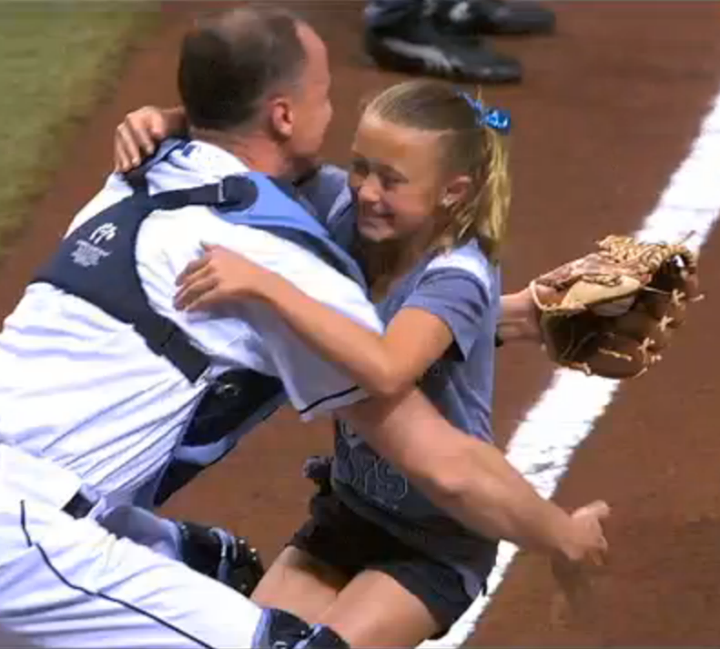 Sports Why We Love Sports Today: 9-year-old Alayna Adams throws out the first pitch at a Rays game, and is surprised to find her dad, home from Afghanistan, behind the plate.  WATCH: http://es.pn/12Hh7Gv