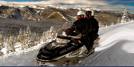 Snowmobile Ride the Continental Divide on Colorado snowmobiling trails as you never have before. Tours top out at nearly 12,000 feet.  Arrange your sled trip at grandadventures.com