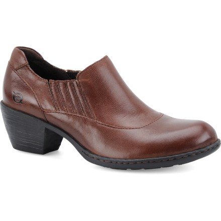 Styled like your favorite pair of boots but easier to slip on and off, the Born Rissa shoes offer sophisticated style and cushioned support for everyday use. Handcrafted leather uppers resist daily wear and tear; durable rubber outsoles provide traction. Steel shank provides excellent arch support for all-day comfort. 1-1/2 in. western-style stacked heel adds height while remaing stable and comfortable. Overstock. - $69.73