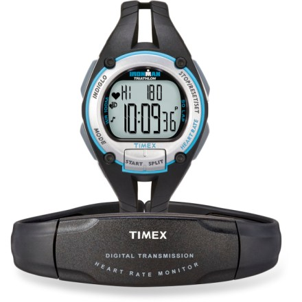 Camp and Hike Just like your training partners that always push the pace, the women's digital Timex Ironman Road Trainer heart rate monitor helps you get the most out of every workout. Preset your desired heart rate exercise zone; an alarm will warn you when you have gone out of your zone. Average heart rate is given for total workout, for each lap and for total time in your zone. Provides total calories burned and displays percentage of maximum heart rate. Recovery heart rate timer measures your heart rate after a timed recovery either during or after your workout. Maximum heart rate zone calculation automatically sets your 5 training zones; 1 manual zone included. Digital transmission protects your data from crosstalk with other heart rate monitors and electronic interference from exercise equipment. INDIGLO(R) night-light illuminates the display for easy use at night. 100-hr. chronographs with lap and split options; 50-lap memory; 100-hr., 2-mode countdown timer; water-resistant to 100m. Includes heart rate sensor with adjustable chest strap; water-resistant hatch in heart rate sensor accommodates quick and easy battery changes. Overstock. - $31.73
