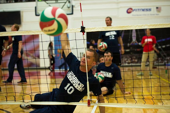 Sports COLORADO SPRINGS, Colo. (May 13, 2013) Retired Aviation Structural Mechanic 1st Class Andrew Johnson, from San Antonio, Texas, spikes the ball during a warm up drill before competing in a seated volleyball match at the 2013 Warrior Games. More than 200 wo