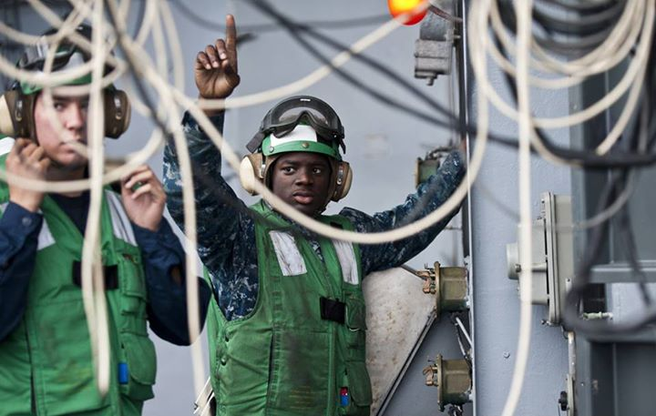 Guns and Military PACIFIC OCEAN (May 10, 2013) Aviation Machinist's Mate Airman Rashad Wright signals for a start-up during a jet engine test on the fantail aboard the aircraft carrier USS Carl Vinson (CVN 70). Carl Vinson and Carrier Air Wing (CVW) 17 are currently underw