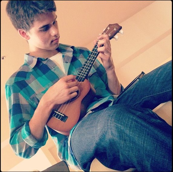 Entertainment Check out John Luke playing his ukulele! Wonder what song he's playing?