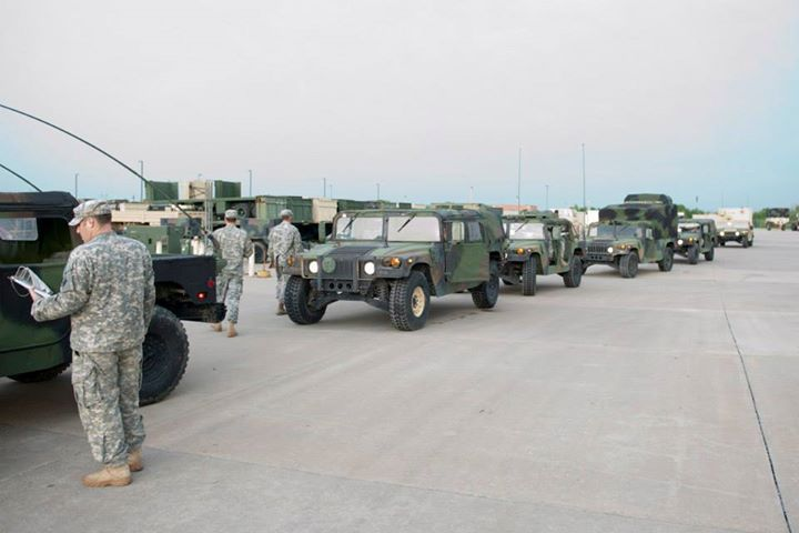 Guns and Military Members of the 700th Brigade Support Battalion, 45th Infantry Brigade Combat Team fuel vehicles before heading to the tornado ravaged area of Moore, Okla. The 700th is currently serving as the Oklahoma National Guard's quick reaction force and was on the