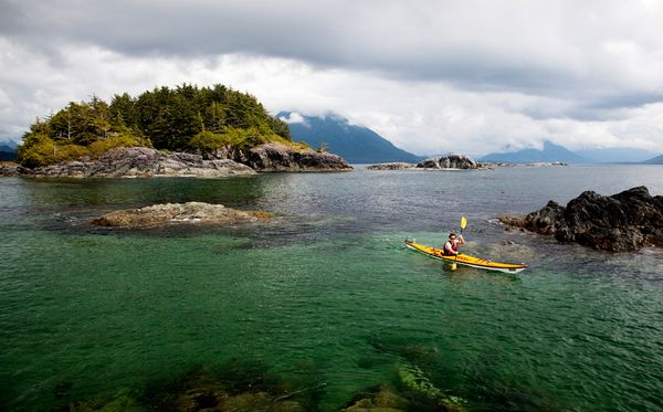 Kayak and Canoe A sea kayaker explores the clear waters off Flores Island near the western coast of Vancouver Island - from National Geographic's Ultimate Adventure Bucket list 2012
