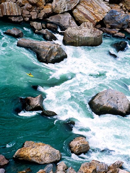 Kayak and Canoe A kayaker braves the Yarlung Tsangpo in Tibet
