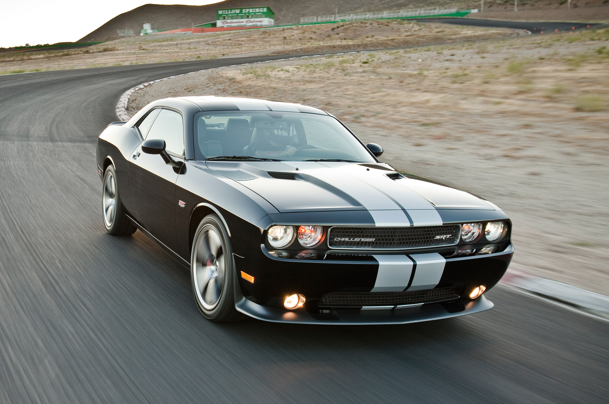 Auto and Cycle Hellcat? Dodge Challenger May Gain 6.2-Liter Supercharged V-8.  Article by Jake Holmes posted May 20, 2013