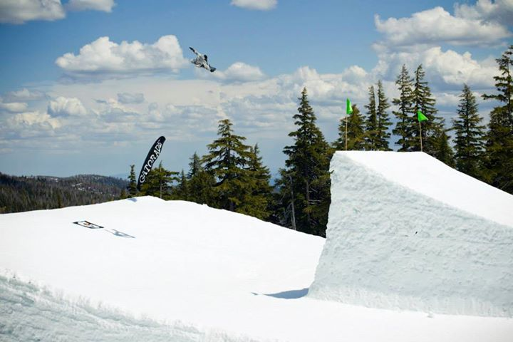 Snowboard DC Snowboarding's Justin Fronius sending a lofty BS 720 Tail grab.