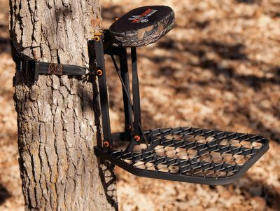 Simple set-up and ultrastealthy construction make the Horizon Hang-On Treestand an easy choice for hunters seeking performance without the hassle. Level up to 60 swiftly and easily with just a twist of the adjustment knob. Rectangular tubing construction is significantly stronger than traditional square tubing without adding a lot of weight a breeze to pack and carry. A 2-padded seat flips up and out of the way perfect for standing, or difficult-angle shots. D-force expanded metal grates provide superior traction, while orange nylon washers at all connection points eliminate squeaking. Powder-coated, textured finish for a no-slip grip. Stand is tested to TMA standards and includes a full-body safety harness with Suspension Relief System (SRS) and one 2 heavy-duty ratchet strap. Imported. Seat height: 22. Seat size: 14 x 8. Platform size: 20 x 23. Weight: 21 lbs. Weight capacity: up to 300 lbs. A Video Public Service Announcement from the TREESTAND MANUFACTURERS ASSOCIATION Color: Platinum. Type: Steel. - $83.88