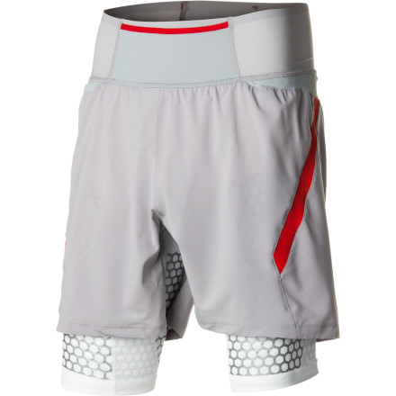Camp and Hike You keep your car in a garage and your fancy sunglasses in a case. It only makes sense to keep your invaluable legs securely covered in the Salomon Men's EXO S-LAB Twin Skin Short. This high-tech running short, made with space-age fabrics for the ultimate performance enhancement, provides muscle support in breathable, sweat-wicking comfort. The EXO Sensifit Stability Technology helps improve posture with honeycomb polyurethane compression, while a gusseted crotch, allover stretch, and ventilating mesh keep you happy and comfortable on those otherwise punishing workouts. The supportive protection of this short is so sleekly invigorating, it almost feels like cheating. - $139.95