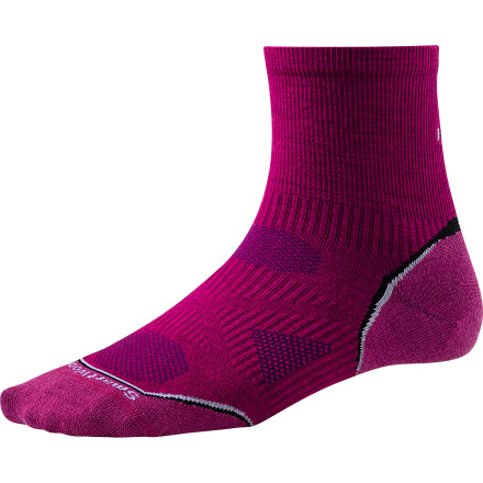 MTB Smartwool loads all of its socks with a ton of technology to help you go further and faster. The Women's PhD Cycle Ultra Light Mini Sock combines strategically placed shock-absorption and a snug, women-specific fit for a sock that you just won't believe.Smartwool builds the PhD Cycle Ultra Light Mini Sock with its 4-degree Fit System, which is comprised of two different types of elastics for enhanced stretch and recovery. Patent pending Relia-Wool Technology in high-impact areas protects your foot from shock and vibration to reduce fatigue. Finally, Smartwool's low-profile toe seam reduces irritation and blistering, so you can ride longer, harder. The Smartwool Women's PhD Cycle Ultra Light Mini Sock is available in Small, Medium, and Large. It comes in Berry, Silver, and Black. - $15.95