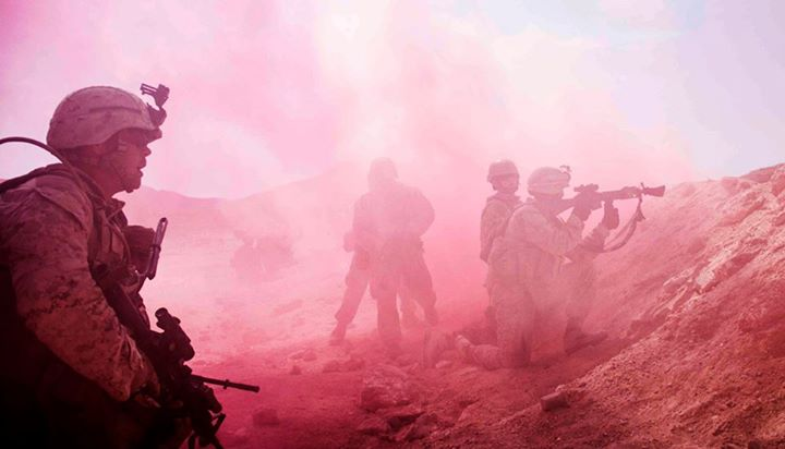 Guns and Military LETHAL IN PINK  Marines with Company K, Battalion Landing Team 3/2, 26th Marine Expeditionary Unit, assault through a smokescreen during a mechanized raid with soldiers from the Royal Army of Oman during Exercise Sea Soldier 2013 in Rabkut, Oman, April 29