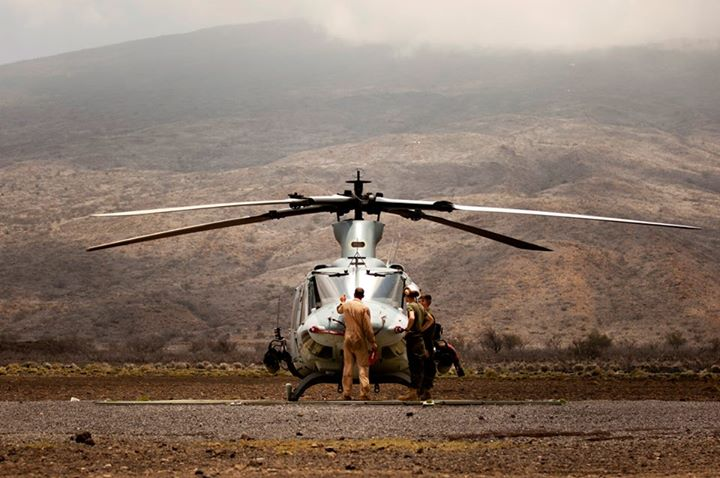 Guns and Military HELICOPTER CARE   Marines with Marine Light Attack Helicopter Squadron 367 (HMLA-367) conduct maintenance inspections on a UH-1Y helicopter at Pohakuloa Training Area, Hawaii, May 10, 2013. HMLA-367 is conducting a nine-day training cycle on the Big Islan