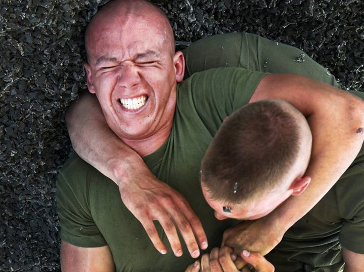 Guns and Military ADVANCED HEADLOCK  Pfcs. Dylan Murphy and Nicholas Reis, infantrymen, Company C, 1st Battalion, 7th Marine Regiment, spar during the Marine Corps Martial Arts Program May 13, 2013, at Marine Corps Air Ground Combat Center Twentynine Palms, Calif. The Mari