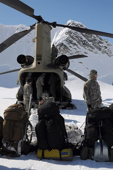 Guns and Military Members of the climbing team unload gear from a U.S. Army Alaska Aviation Task Force CH-47 Chinook helicopter on Kahiltna Glacier May 20. The team of eight Soldiers and one Army civilian from Fort Wainwright were transported by 1st Battalion, 52nd Aviatio