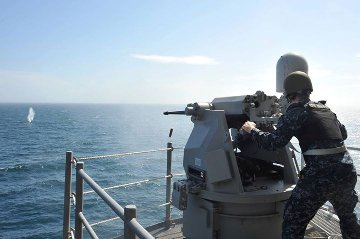 Guns and Military (May 22, 2013) Gunner's Mate 3rd Class James Adams fires the MK 38 MOD2 25mm machine gun during a training exercise on the weather deck aboard the multipurpose amphibious assault ship USS Bataan (LHD 5). Bataan is underway in the Atlantic Ocean conducting