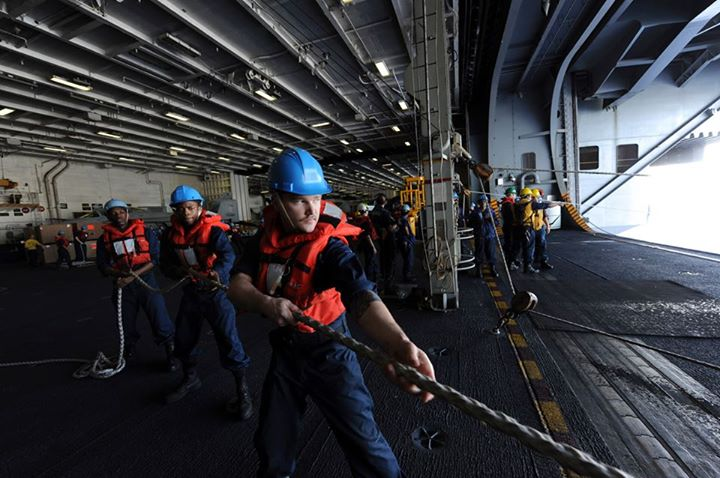 Guns and Military (May 21, 2013) Line handlers aboard the aircraft carrier USS Nimitz (CVN 68) prepare for the receiving of supplies from the U.S. Navy's Military Sealift Command fast combat support ship USNS Rainier (T-AOE 7) during a replenishment-at-sea. The Nimitz Carr