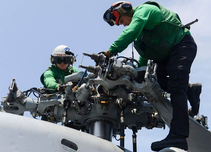 Guns and Military (May 20, 2013) Sailors assigned to Helicopter Maritime Strike Squadron (HSM) 75 perform helicopter maintenance on the flight deck of the aircraft carrier USS Nimitz (CVN 68). The Nimitz Carrier Strike Group is deployed to the U.S. 7th Fleet area of respon