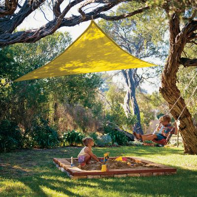 Camp and Hike Youll love the massive amount of shade created by the Coolaroo Party Sail. The large and super-durable triangle shade sail is made of high-density, UV-stabilized polyethylene, so it resists mold, mildew and stains. Not only that, its knitted and breathable fabric does not trap heat and humidity, reducing ambient temperature. Lightweight and portable, it compacts to fit in a backpack. The included 6-ft. nylon ropes attach to each grometted corner for stability. Cleans quickly with garden hose. Easy to install, no tools required. Imported. Dimensions: 910L x 910W. Colors: Blue, Green, Orange, Red, Yellow. Color: Red. - $34.99