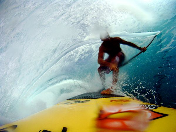 Surf Stand Up Paddle Surfing in Tahiti